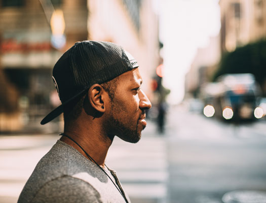 Man with hat in street