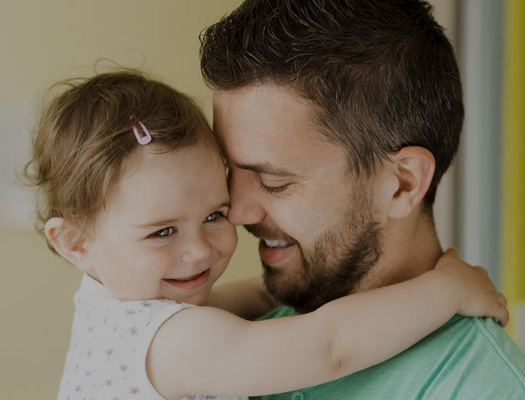 Daughter bringing depressed father happiness