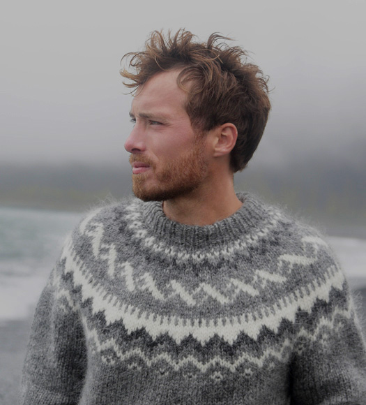 Man in sweater at beach