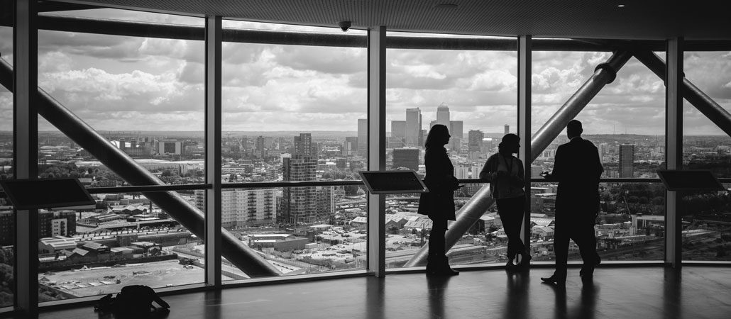 People meeting in office space with large windows and city view