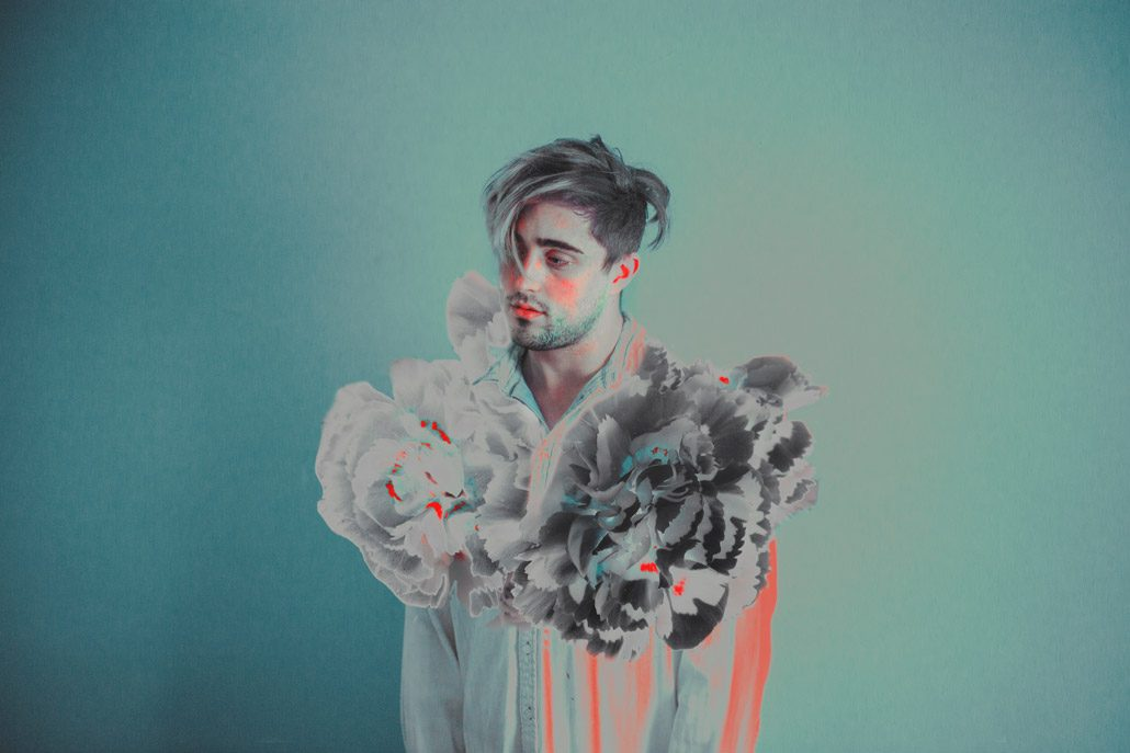 Conceptual self portrait of Ricardo, with flowers and teal and orange colours
