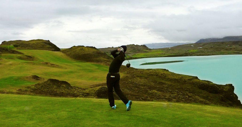 Julian swings golf club