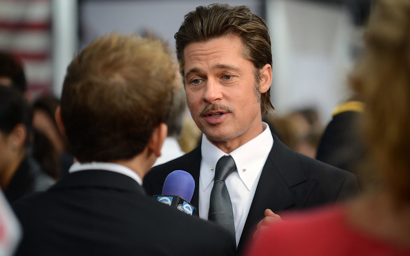 Brad Pitt in suit answering questions at press event
