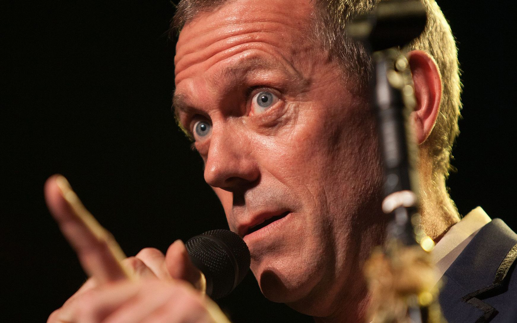 Hugh Laurie with microphone answering questions