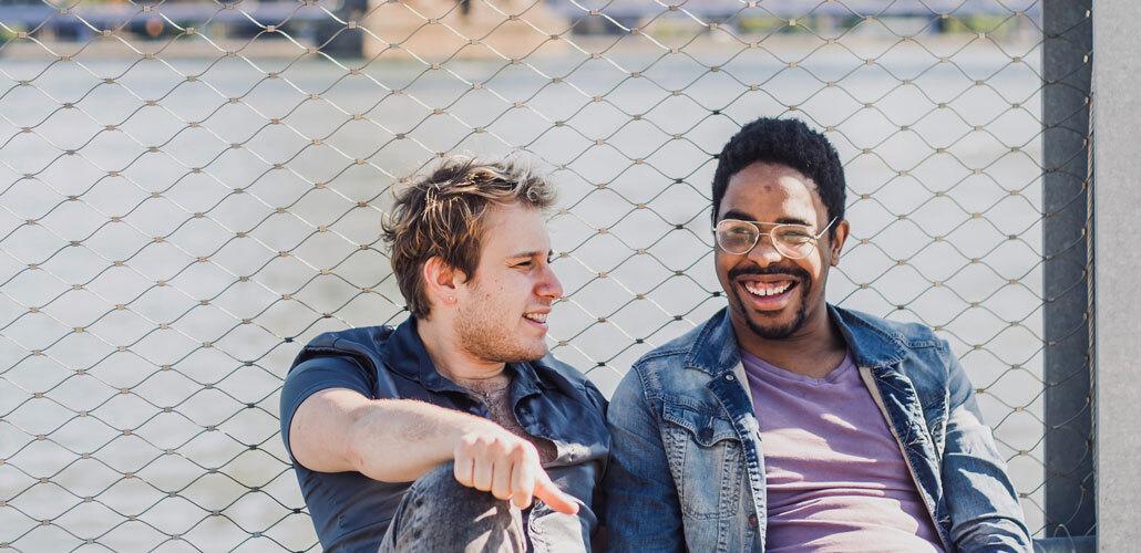 Men Laughing on Fence Big