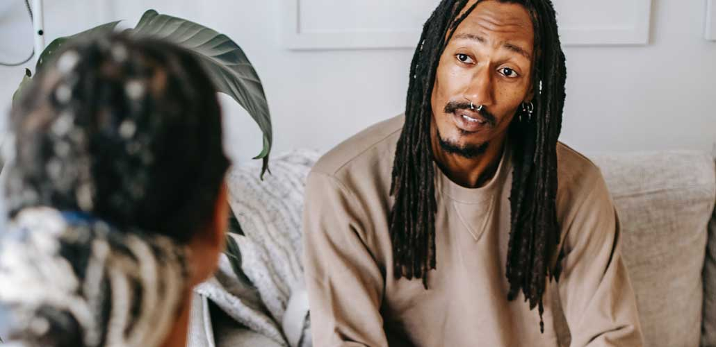 Man speaking with therapist