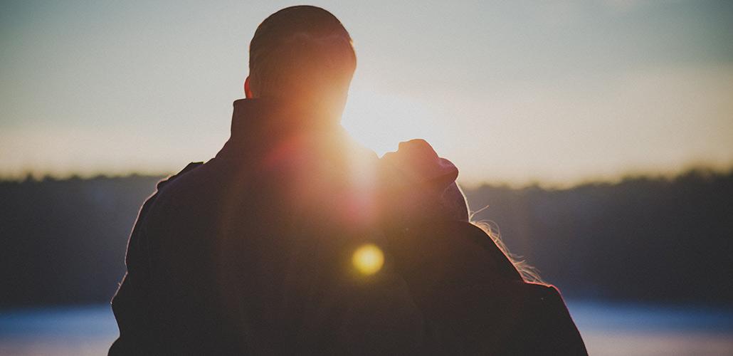 Man and woman watching sunrise