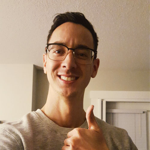 Ryan poses with thumbs up