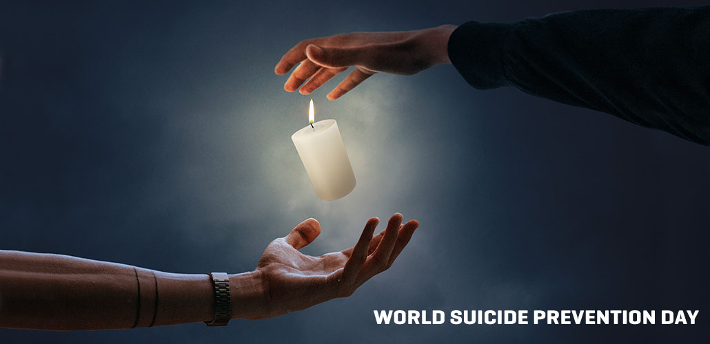 A candle balances between to hands - concept photo